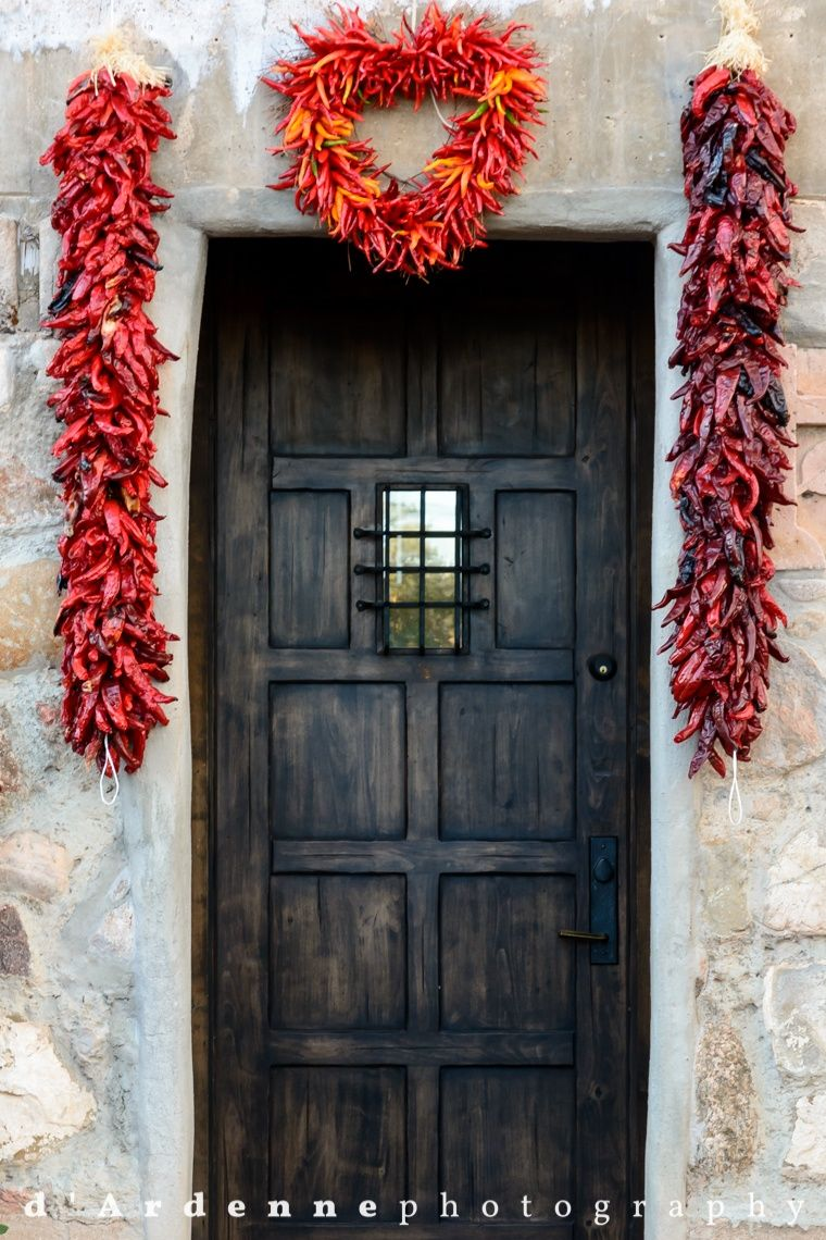 Santa Fe, New Mexico- Hanging red chile ristras say to visitors ...