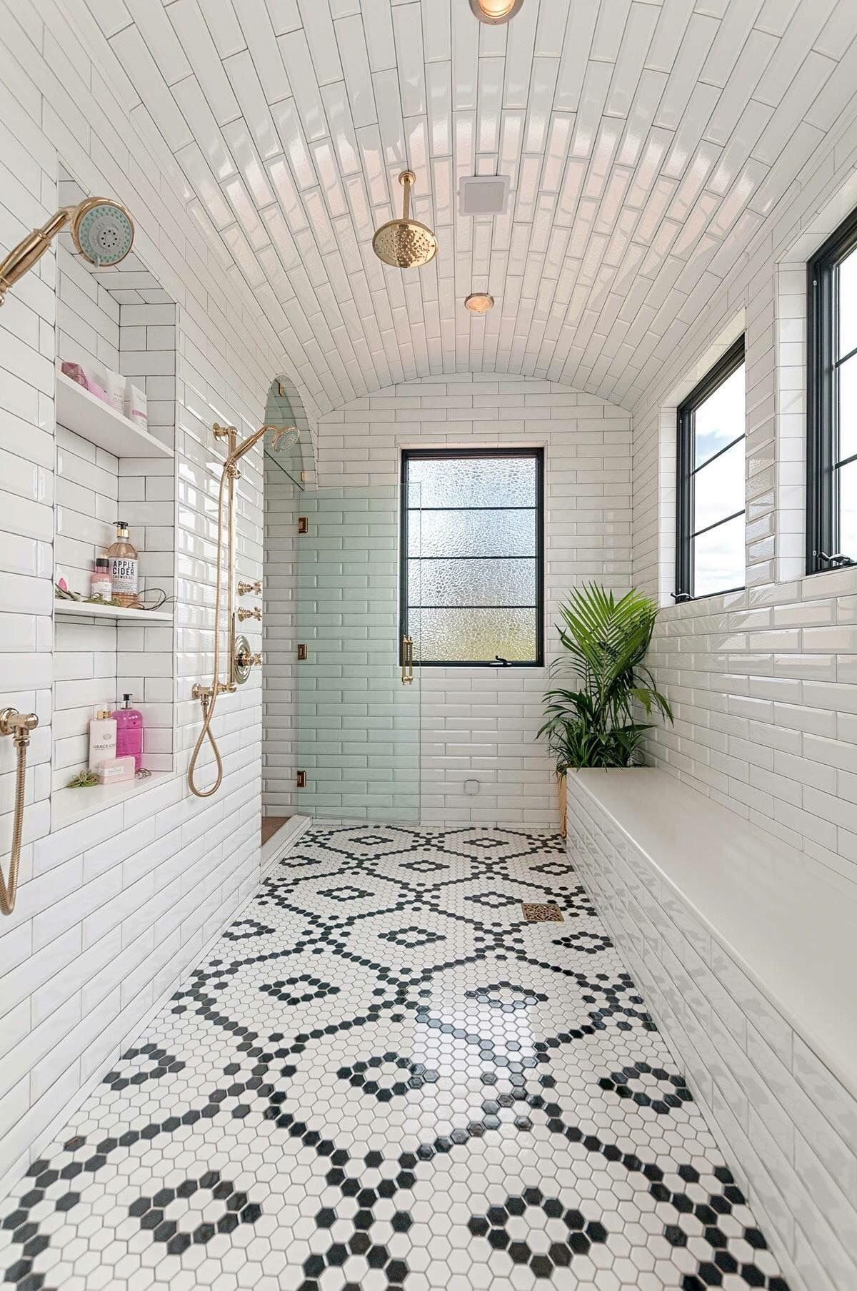 The White Tiles Showcase The Arched Ceiling And With A Monochrome Mosaic Floor Bathroom Tile Designs Dream Bathrooms House Design