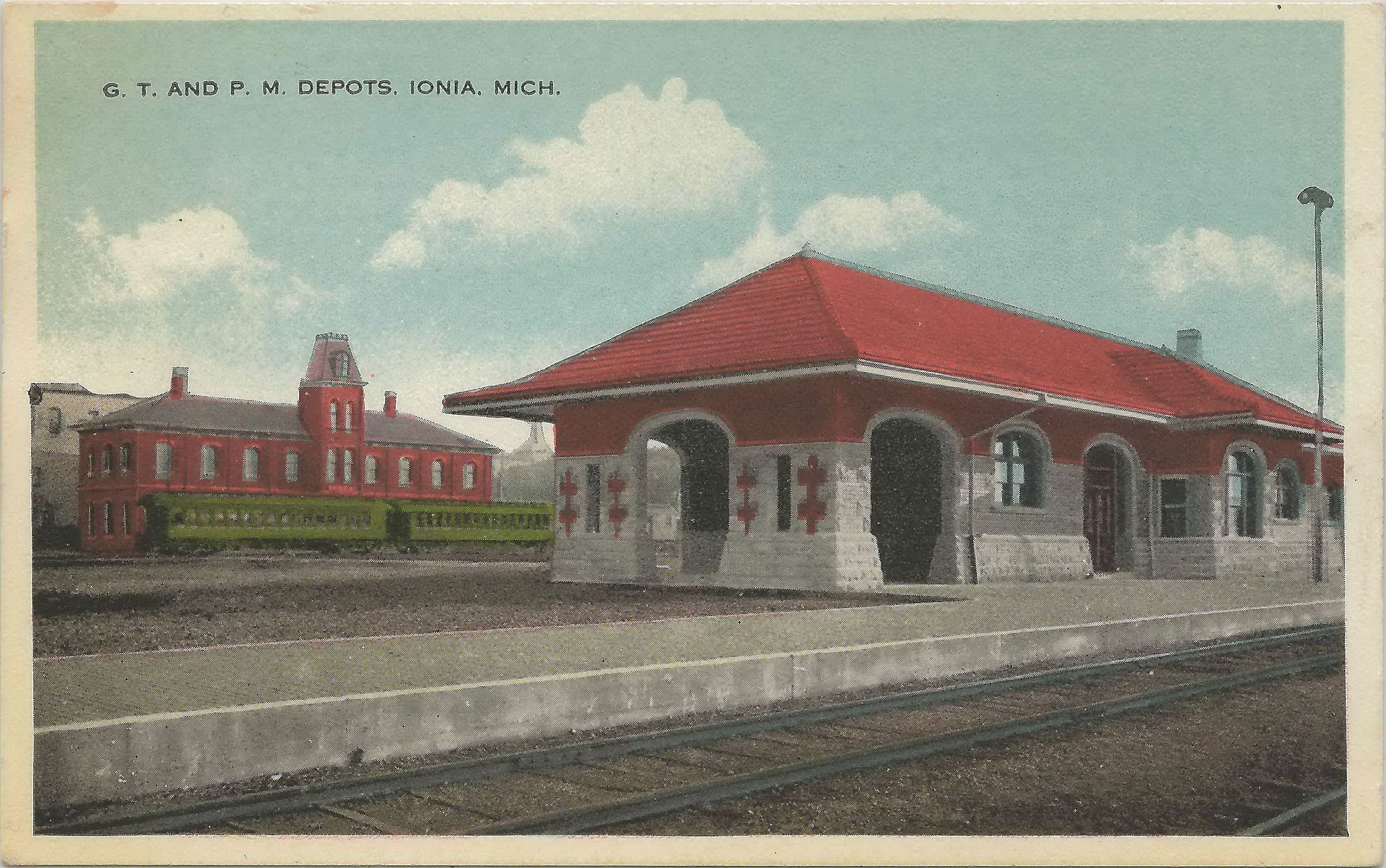 https://flic.kr/p/eREZJP | Ionia MI TWO DEPOTS GTWRR Grand Trunk RR and PMRR Pere Marquette Depot in the background Note the passenger train at the PM station