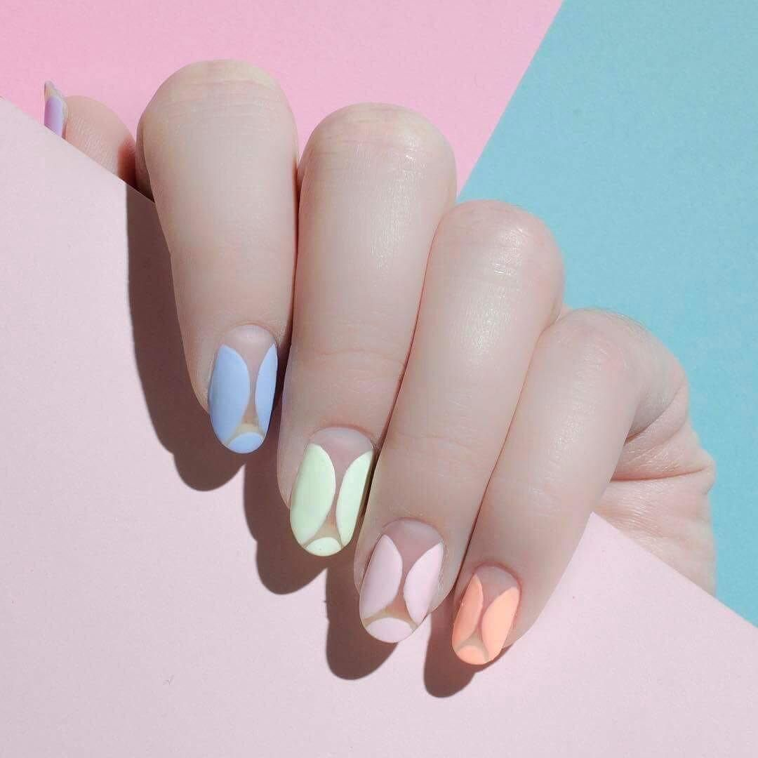 Love this pastel mani that creatively uses negative space ugh so