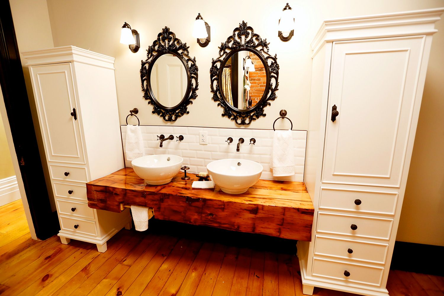 Modern vessel-style sinks pair beautifully with the reclaimed barn ...