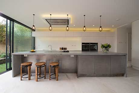 concrete kitchens | this 4m-long concrete island worktop with end