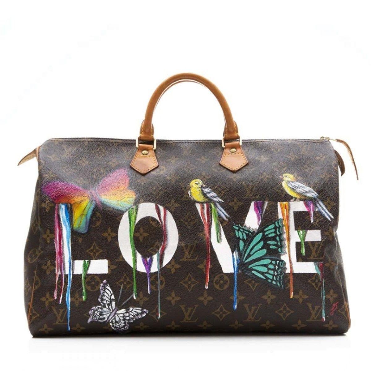 bd0e7ac91b20 Shop vintage designer dresses online now at Farfetch. Louis Vuitton Speedy  Bag