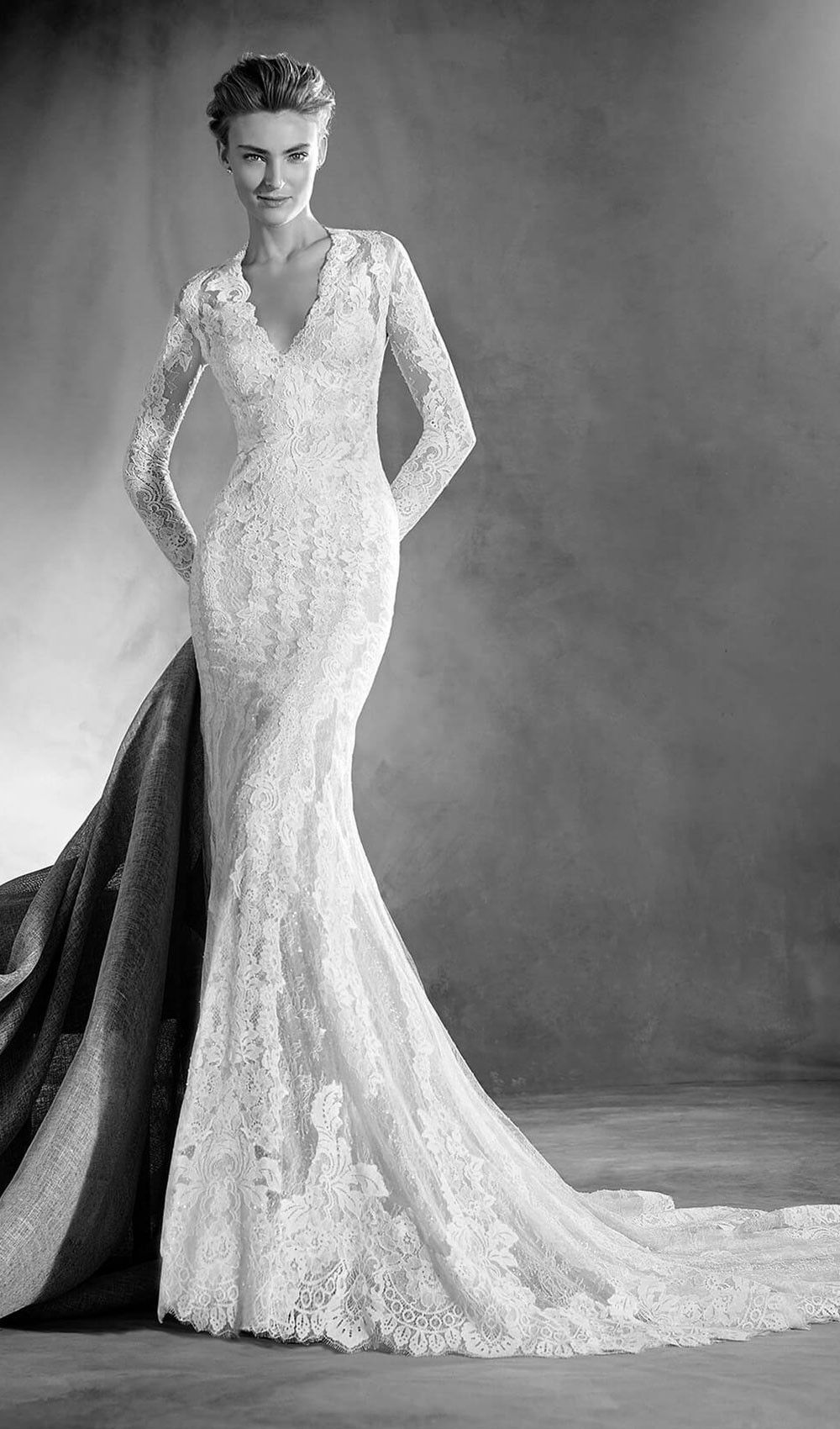 Try this spectacular mermaid wedding dress with a V neckline. Long ...