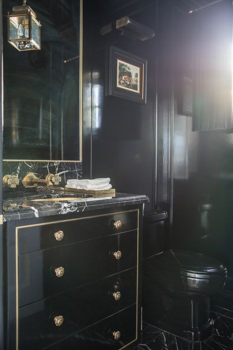 Stunning Black Paneled Powder Room Is Fitted With A Tall Black