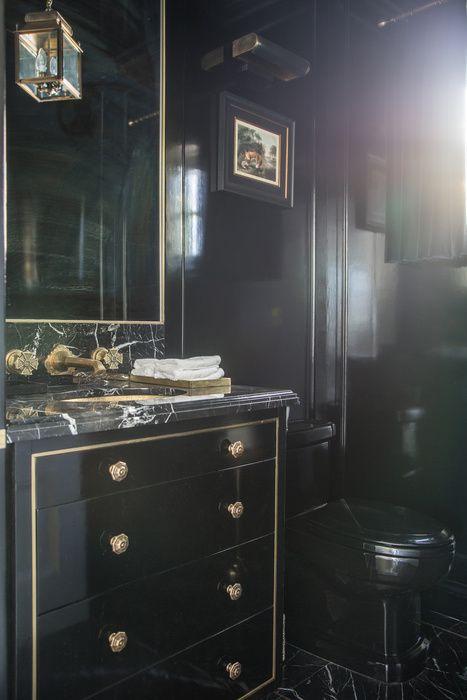 Dana Benson Construction Black Powder Room Features Glossy Black