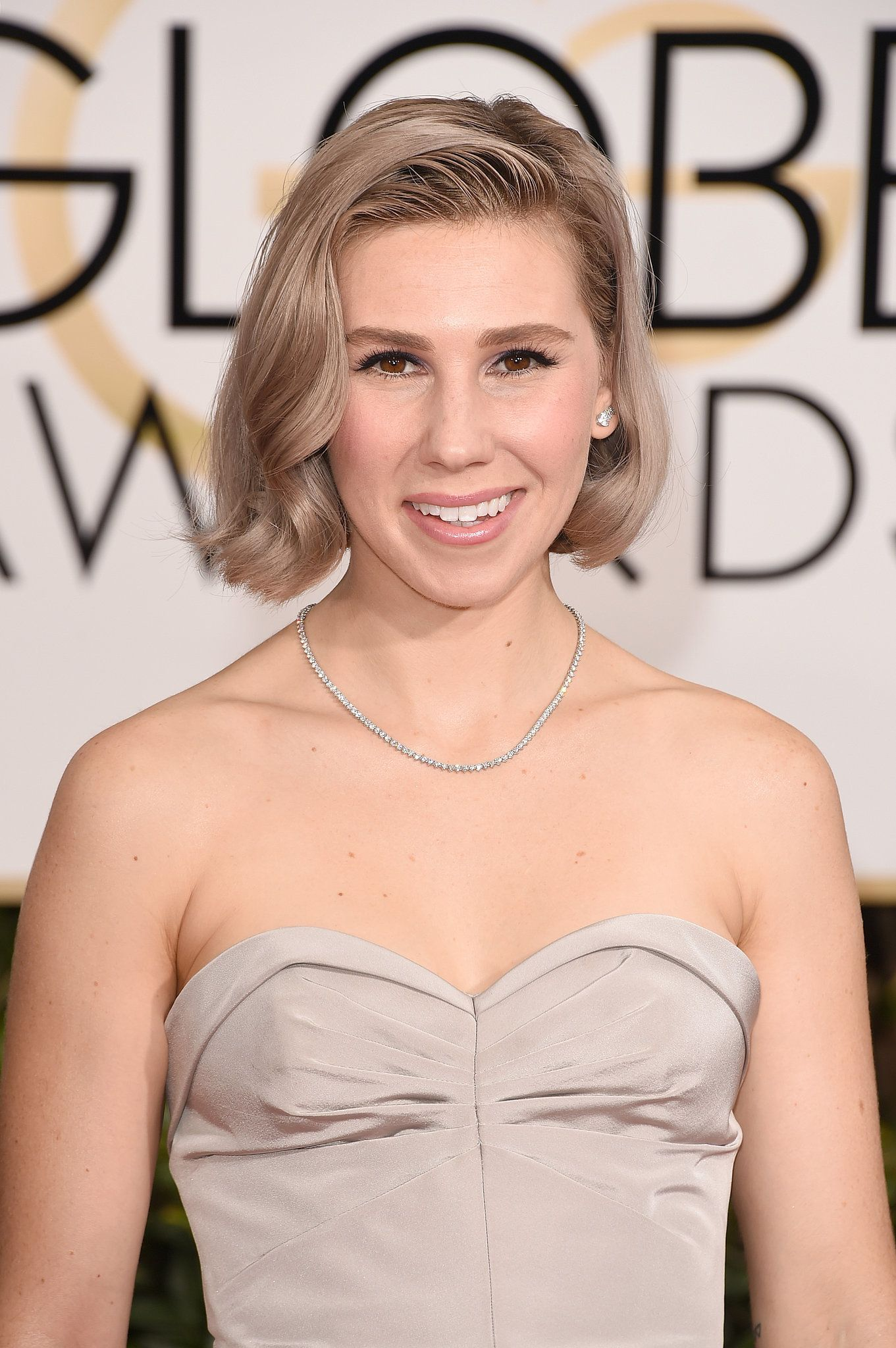 Zosia Mamet's ashy strands and nude makeup keep her monotone style look flawless.