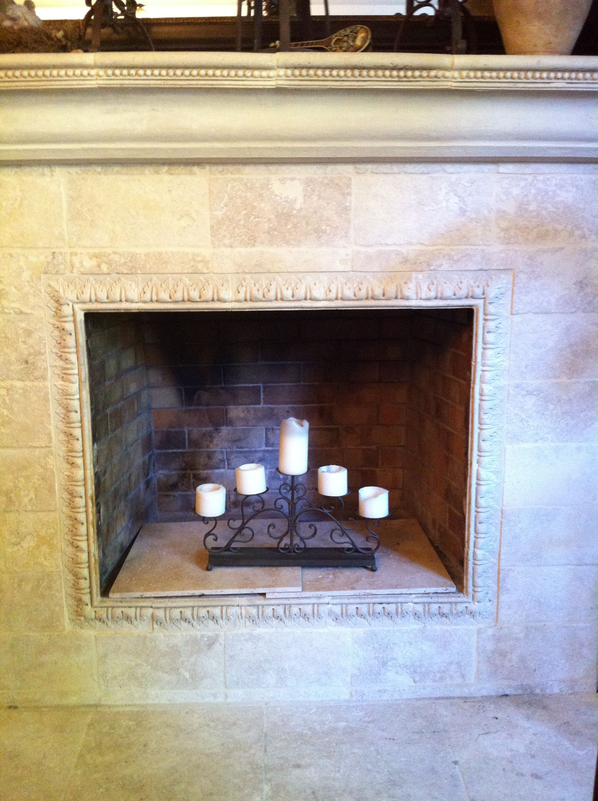 Fireplace reface with tumbled marble over existing brick - How to reface a brick fireplace ...