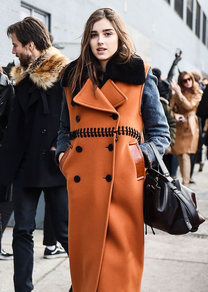Browse the best street style looks from NYFW Fall 2017 via @STYLECASTER | burnt orange coat with black accents