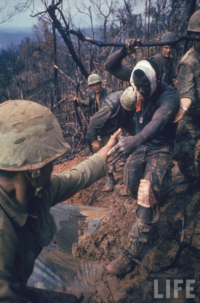 Wounded Marine being helped to an air evacuation point.