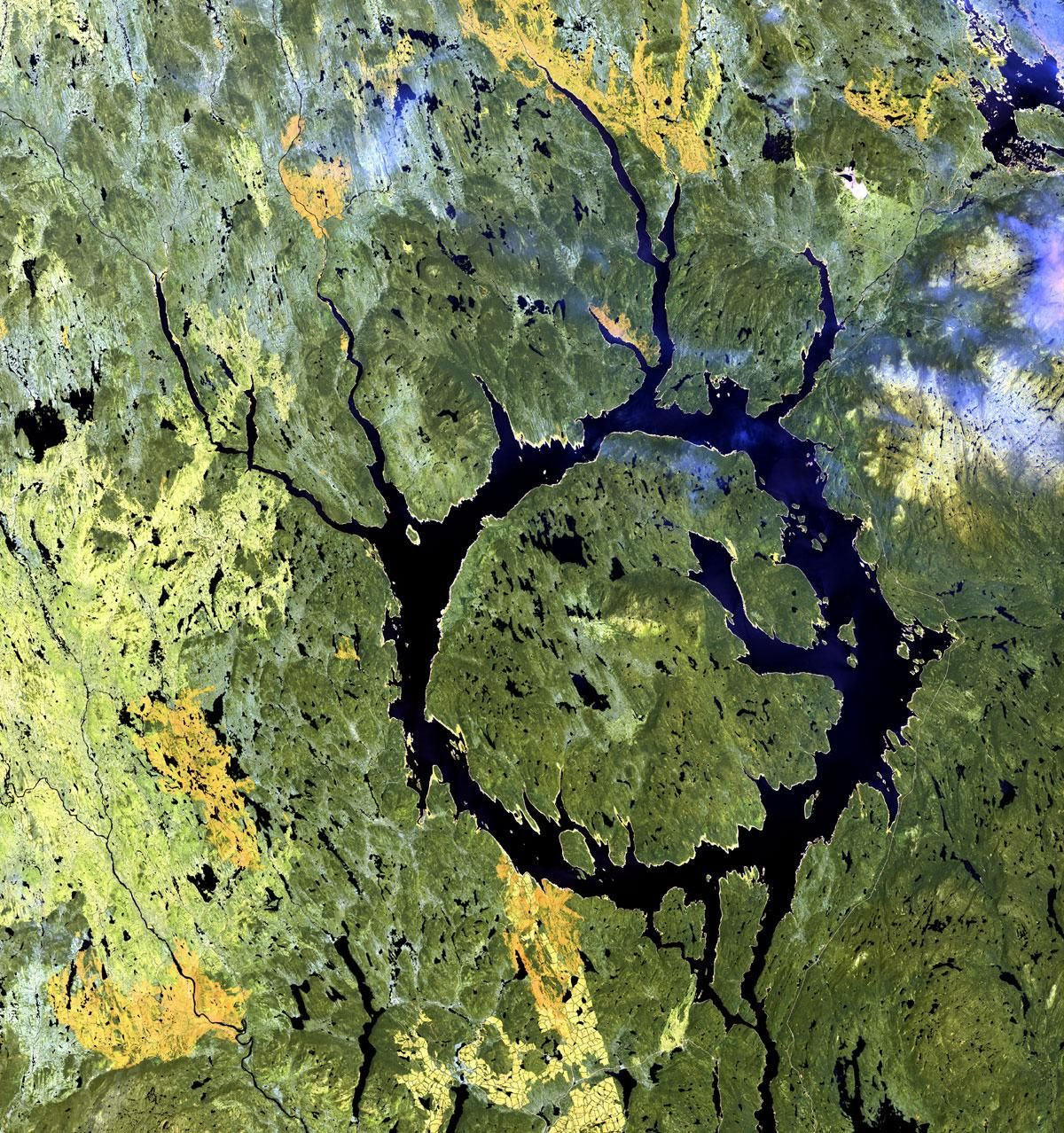 A lake-filled crater, Manicouagan in Quebec is one the largest and best-preserved crater on the planet. The 62-mile-wide (100 km) crater is 214 million years old.