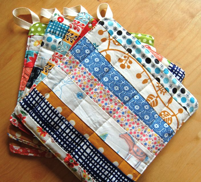 handmade pot holders, oooh I like the scrappy quiltedness of these
