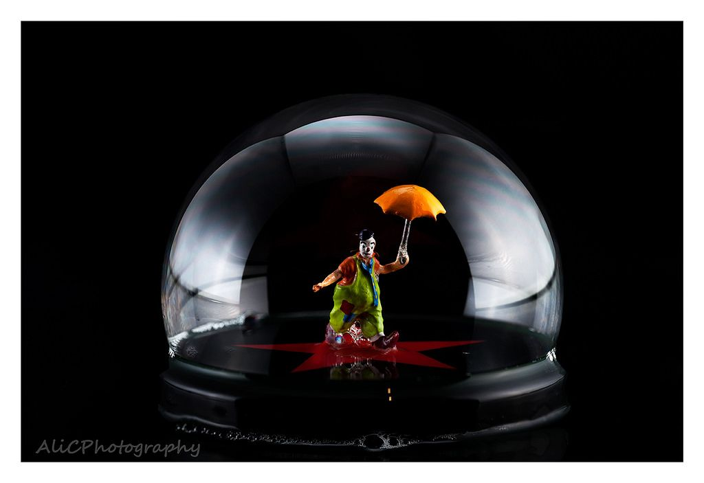 The clown is trapped inside a bubble