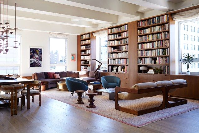 An Expansive Greenwich Village Loft That's Finally Ready for Its Closeup is part of Living Room Chairs Bookshelves - Artist Kerry Scharlin turned to designers Laura Santos and Sandra Weingort to make magic in the 7,000squarefoot livework space