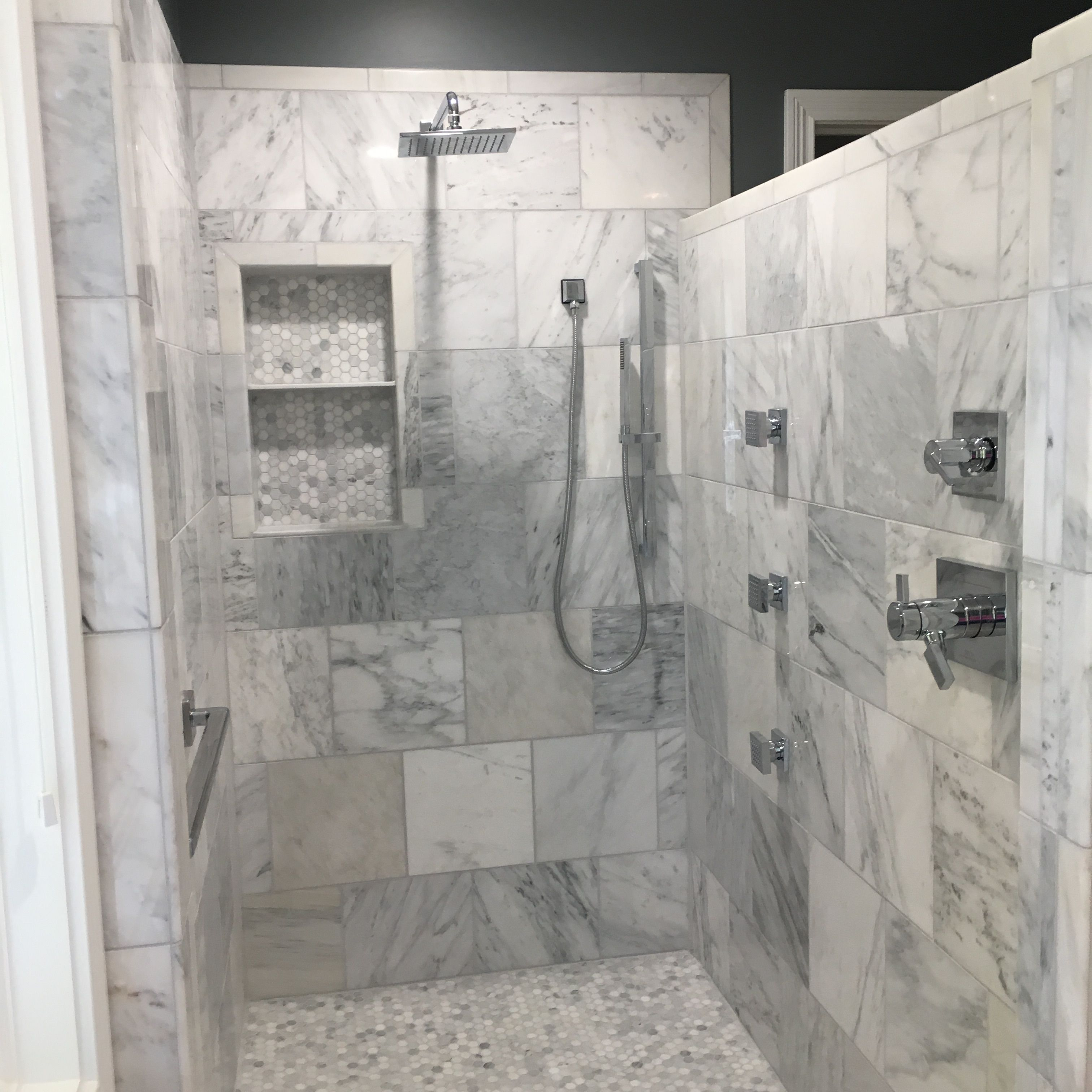 Carrera Marble Walk In Shower With Rain Shower Head Handheld And Three Body Jets Delta Vero Fixtures And Built In With Images Marble Shelf Shower Heads Rain Shower Head