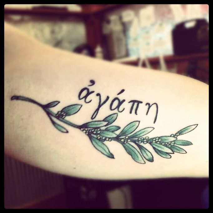 Greek for Agape (unconditional love) with olive branch.  I love the word to sit around my laurel wreath.