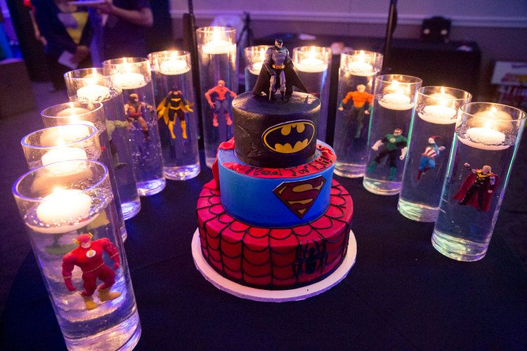 Elis superheros cake table and candle lighting