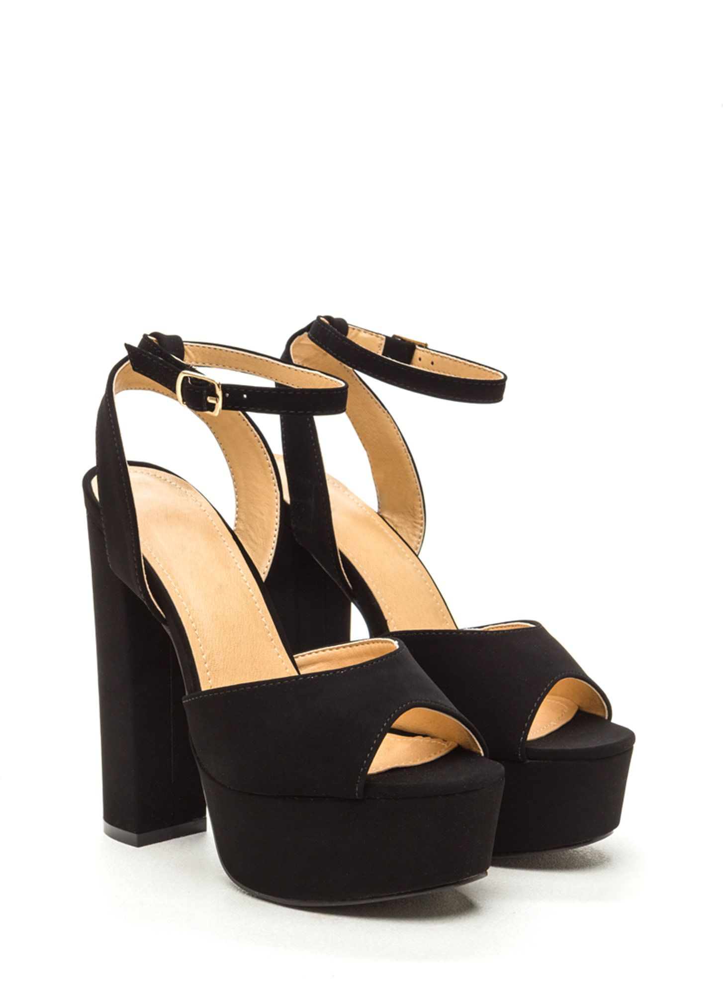 598d552af7 Channel your fave seventies bae in these sky-high platform heels! #heels #