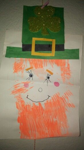 St. Patrick's Day craft using paint, a fork for the hair ...