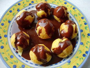 Profiteroles:   Small choux pastry puffs, filled with vanilla ice cream and topped with a rich smooth chocolate sauce.