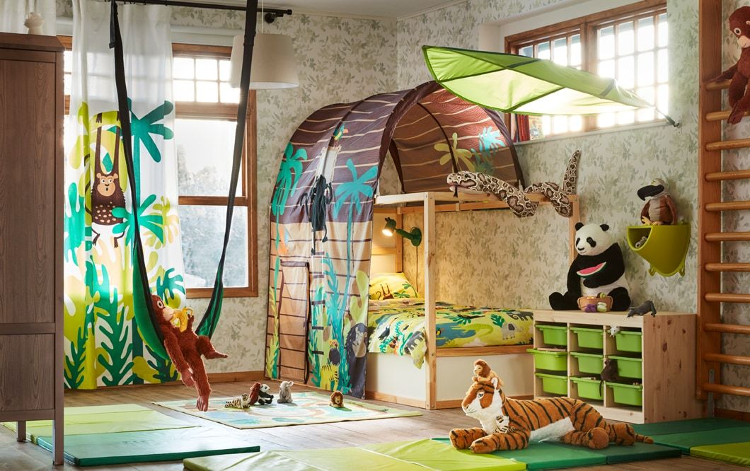 A Brown And Green Jungle Safari Theme Children S Bedroom With Kura