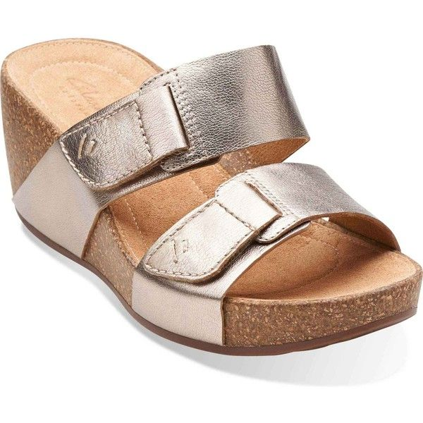Strap in for a stylish ride with the Clarks Temira East wedge sandal. The  supple leather upper of this women's platform slide has dual adjustable  straps for ...