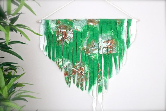 This felted wall hanging is a beautiful accessory to your home decor. It is hand felted by me. It measures: width (dowel): 60 cm (24 inches) length (incl. hanging string) 90 cm (36 inches). xxxxxxxxxxxxxxxxxxxxxxxxxxxxxxxxxxxxxxxxxxxxxxxxxxxxxxxxxxxx Made in smoke-free and