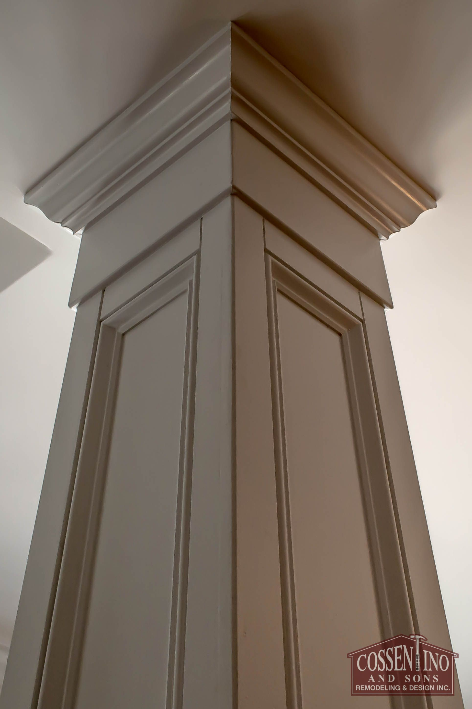 Custom trimmed column hiding an ugly support beam for Interior support columns