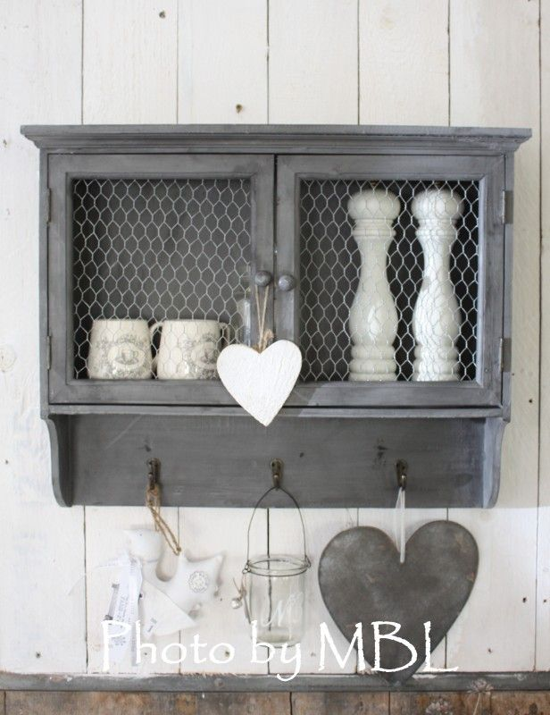 Wall cabinet with chicken wire doors. Painted a nice medium gray ...
