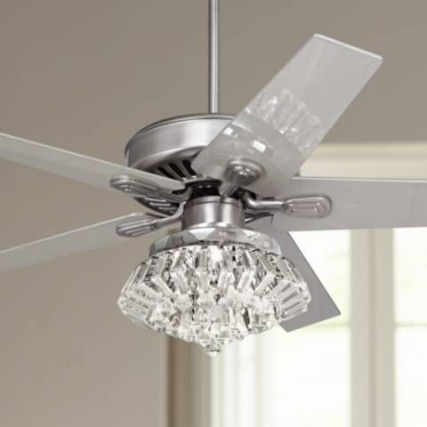 This brushed steel ceiling fan with crystal light kit will make a contemporary decor statement in