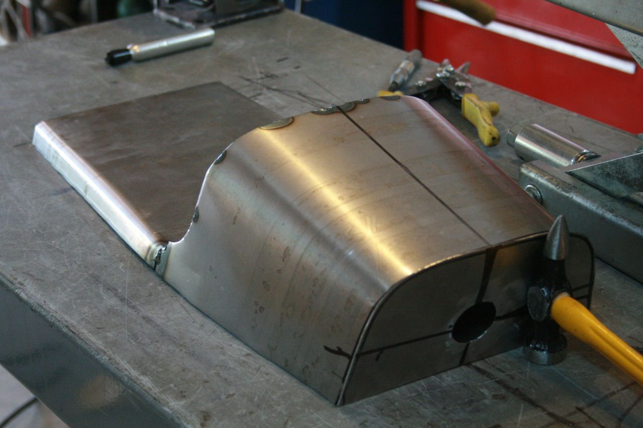 making an oil tank for a cb750 out of the dunstal cafe' racer seat