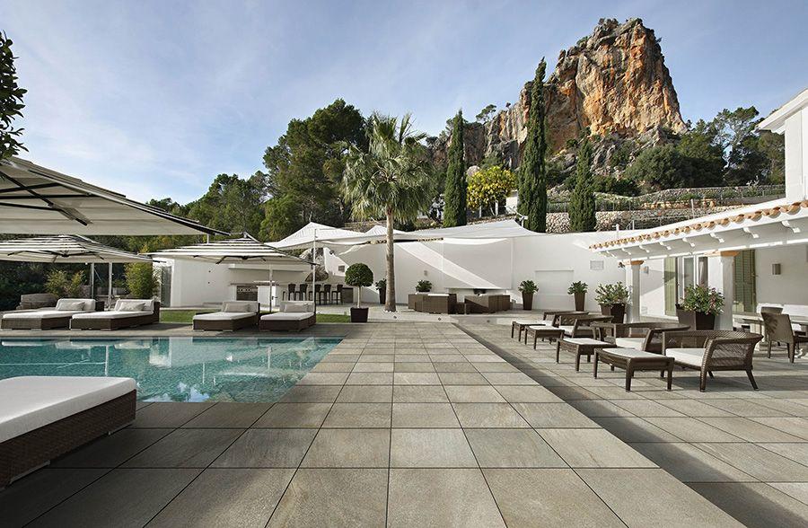 Panaria Bioarch  Wooden deck surrounding outdoor swimming pool , floor , outdoor tile .