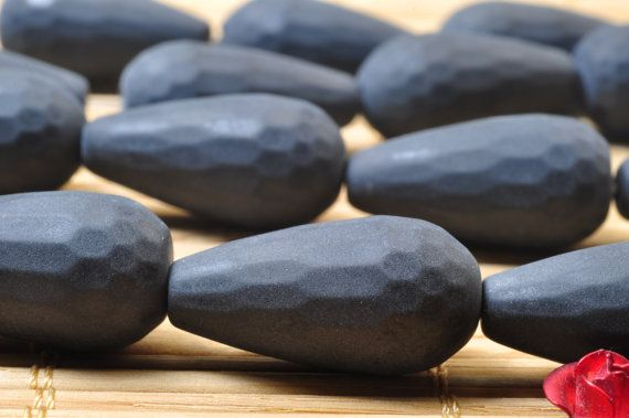 19 pcs of Black Onyx Matte and faceted teardrop beads in 10x20mm