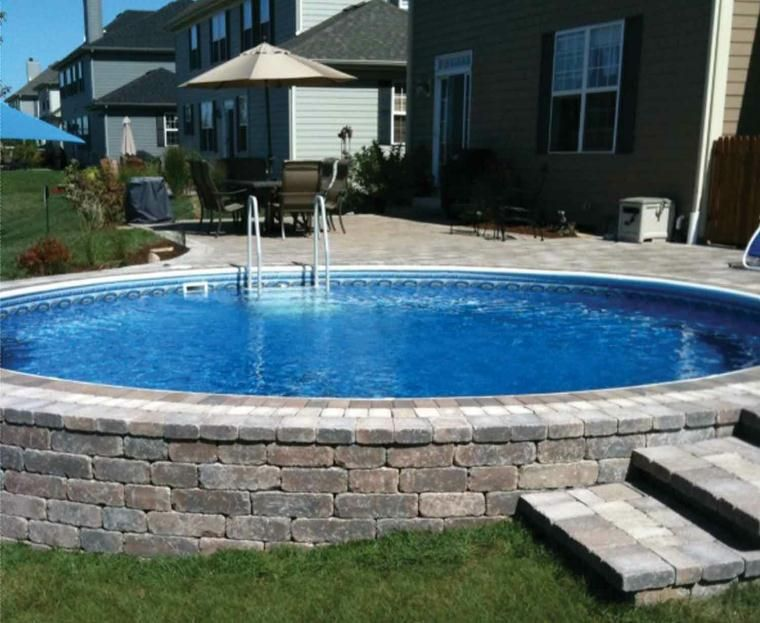 Above Ground Pool With Stone Work Very Nice But Def Needs A Fence For Kiddos