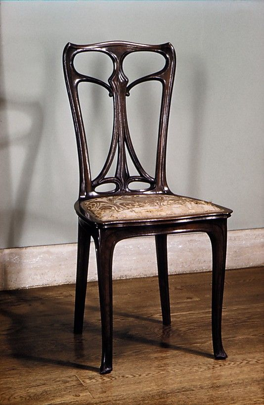 FURNITURE: Side chair by Édouard Colonna, 1899. MeT, N.Y. Siegfried Bing's artist-designers were all distinguished contributors to the development of European Art Nouveau, but his sojourn in America to investigate and report on the decorative arts had given him the vision to range farther afield in his search for designers. Colonna, who had been in the United States since 1882, was recruited by Bing along with Louis Sullivan and Louis Comfort Tiffany.