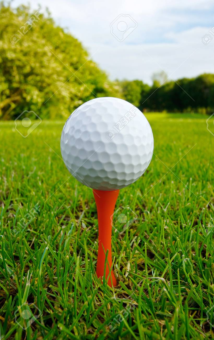 Golf Ball On Tee Close Up With Fairway And Flag In Distance Golf Ball Golf Photography Golf