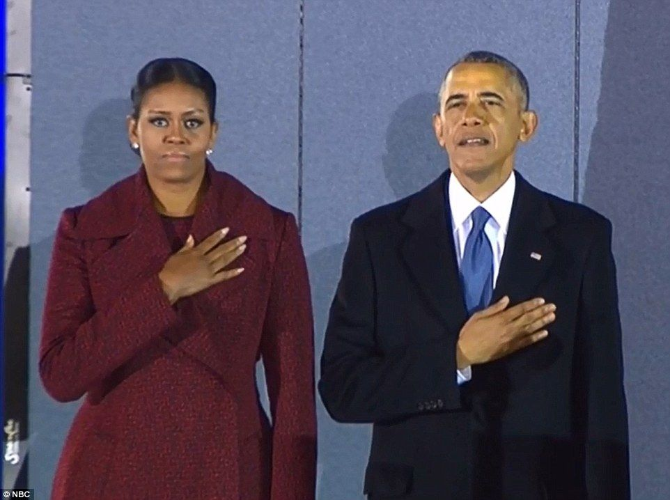 Goodbye: She kept her coat on as she and Barack said their final farewell to the crowd...