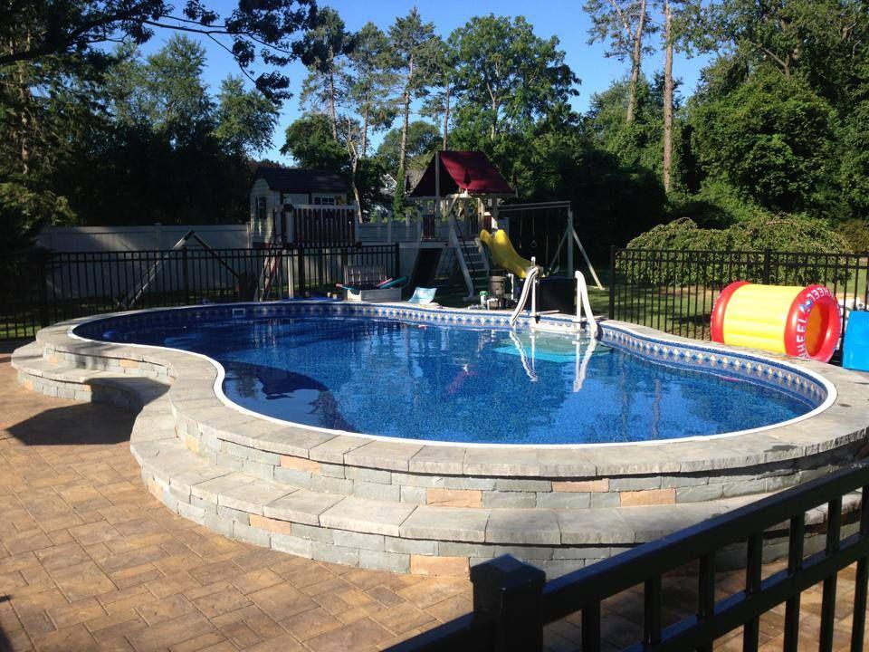 Beautiful Semi Inground Radiant Freeform Pool Above Ground Pool