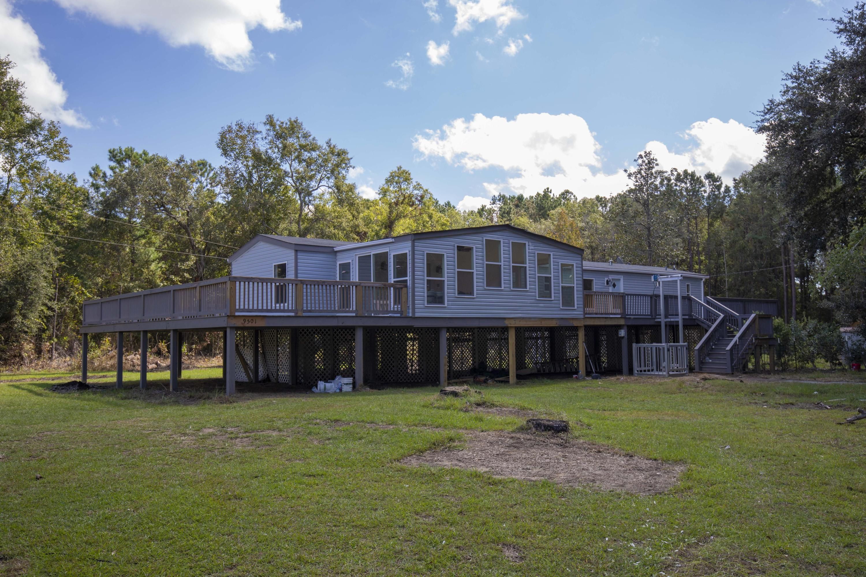 1.7 acres of land with updated 2006 elevated Clayton