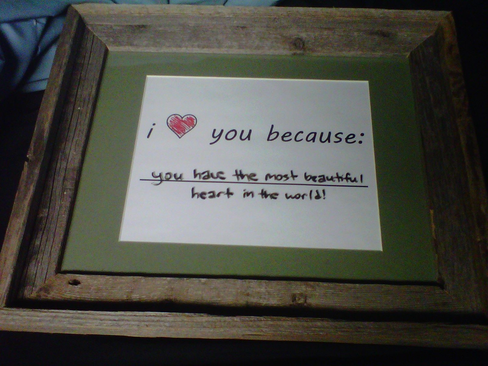 "Simply frame ""I love you because: _______"" and then the glass becomes a dry erase board so you can change it as much as you want!"