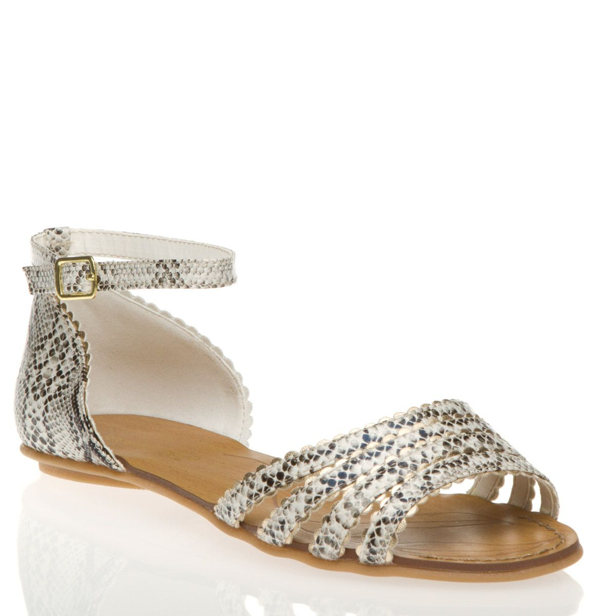 Exotic ankle-strap sandal, and its metallic with scalloped trim.