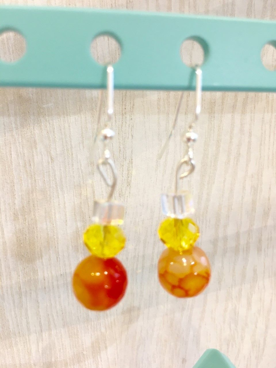 Fire Dragon   Made a powerful statement with this stunning and glamorous pair of earrings. Be provocative and memorable  Materials:   - Orange faceted Agate - Swarovski crystals - Pure Silver .95