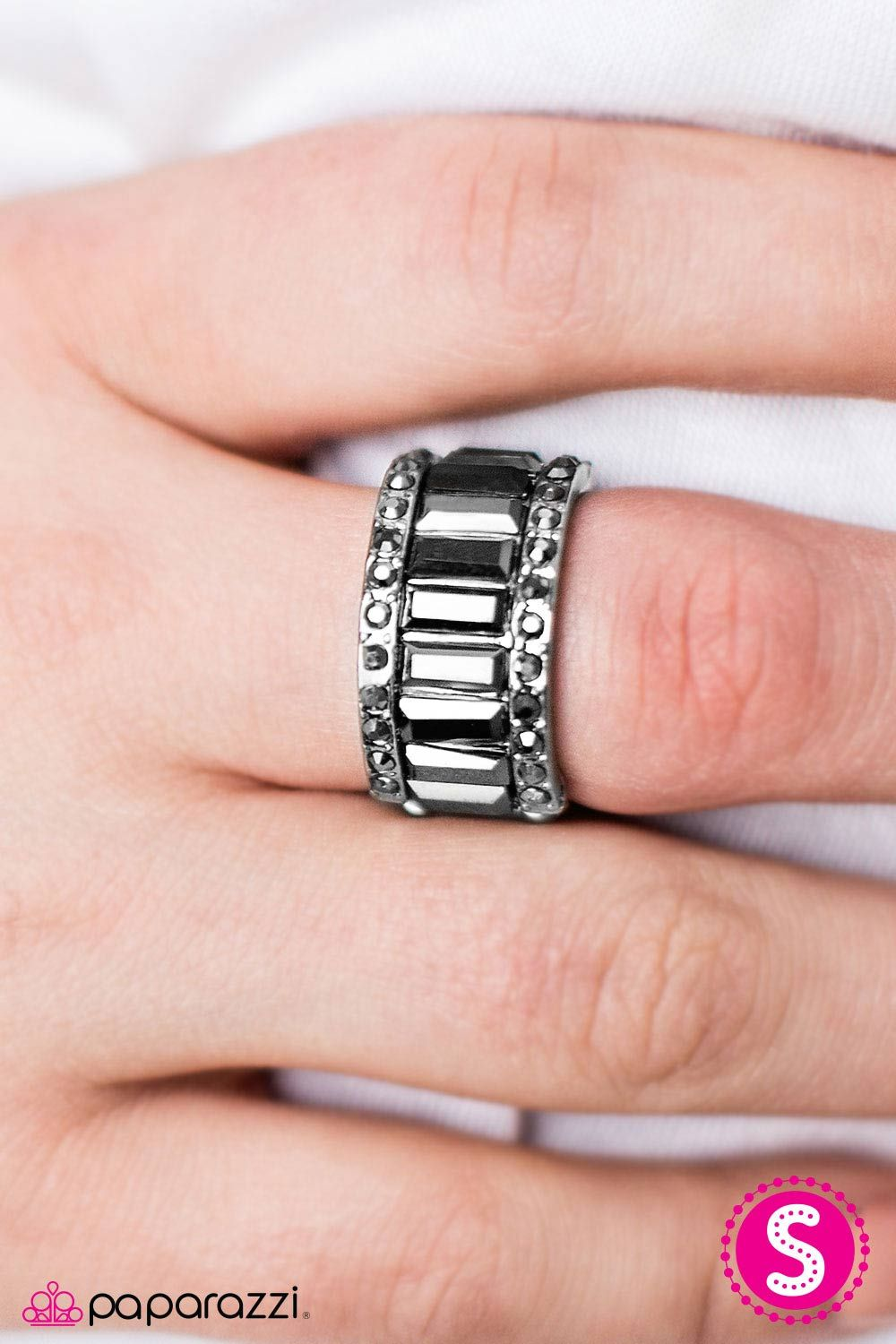 Emerald-cut hematite gems join across the finger. Dotted with ...