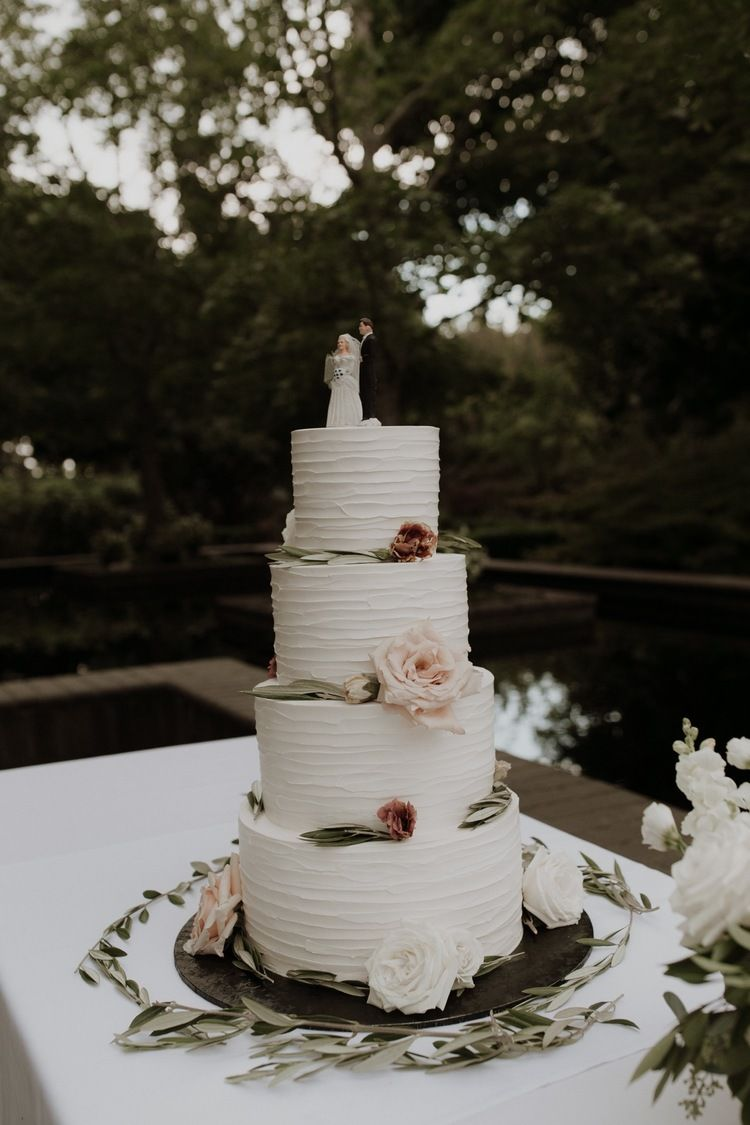 4 tiered cake at garden reception decor, tablescapes