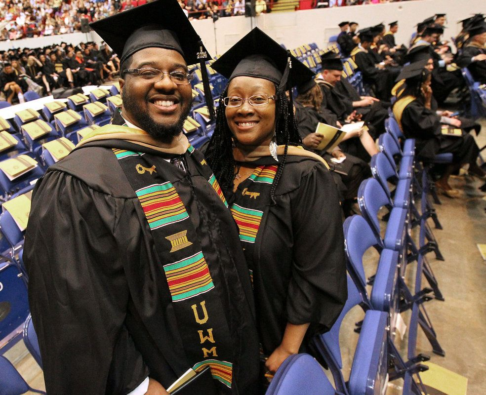 From JSO  Photo Gallery:  UWM graduates Kitonga Alexander and wife Javon Alexander receive their Masters Degree together at U.S. Cellular Arena
