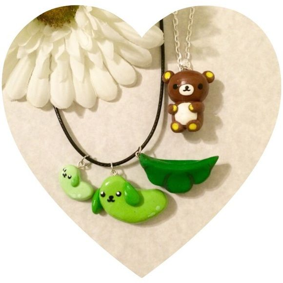 2 Kawaii Necklaces Charm Bear 2 Charm Necklaces and extra charms! Black cord necklace has snow pea puppies and pod and silver chain has a brown bear charm. Jewelry