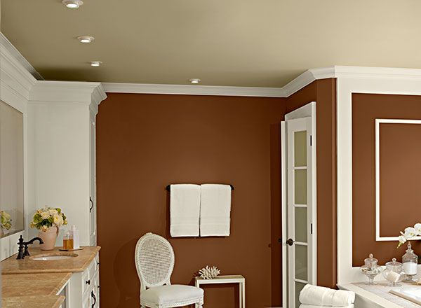 warmed cognac and crisp khaki -- this is very close to the color card we agreed on.  The khaki is on the ceiling instead of the walls, though, where I would put it. It helps me to see it in a room :)