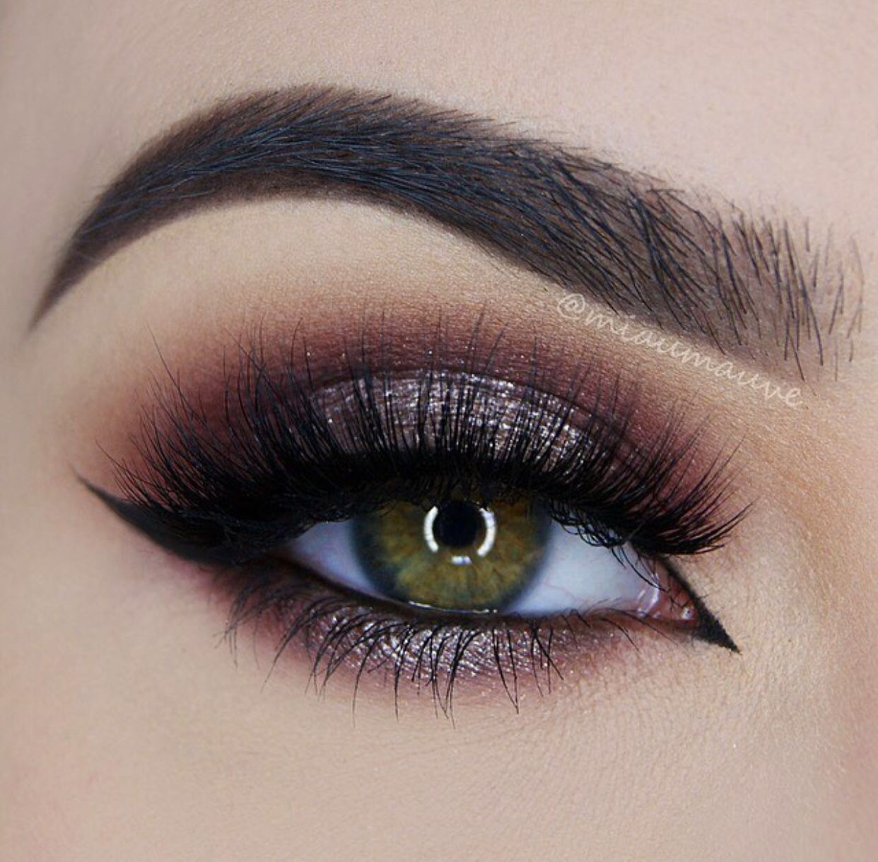 Stunning eye makeup shimmer over rich plum, black eyeliner