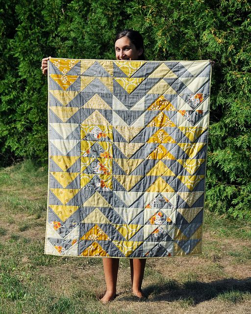 Flying geese quilt, greys and yellows