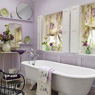 love the lilac walls, vintage mirrors, shutters, floral curtains, gorgeous towels, everything!